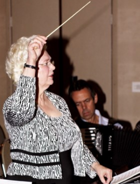 Joan C. Sommers conducting the ATG Executive and Friends Orchestra