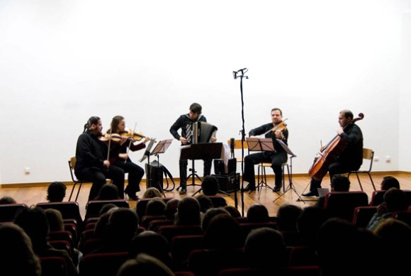 Accordionist João Gentil performs in concert with a string quartet