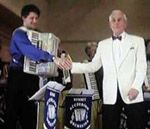 David Watson, conductor of the Kennet  Accordion orchestra, congratulates Nigel Pasby